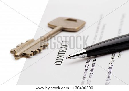 Keys of a new house on a signed contract of house sale with money in background. Concept of closed deal. poster