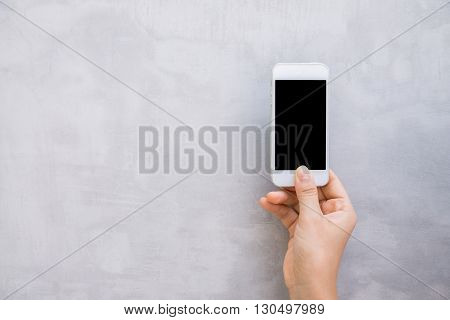 Woman hands with wall cell phone mock up