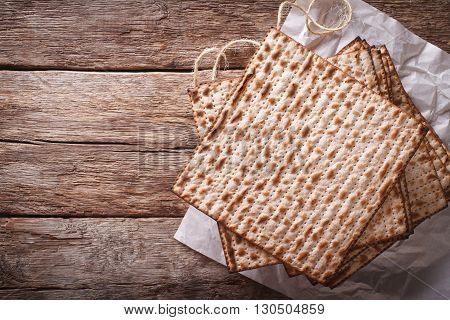 Jewish Kosher Matzah Closeup On Paper On A Table. Horizontal Top View