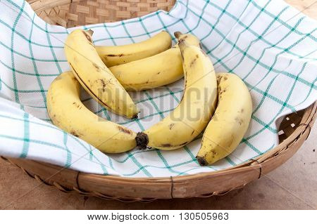 Cavendish Banana in the bamboo basket on table