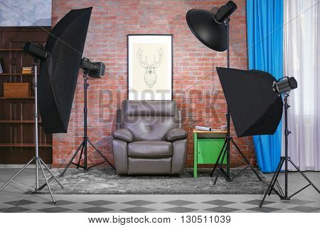 Photo studio interior on brick wall background