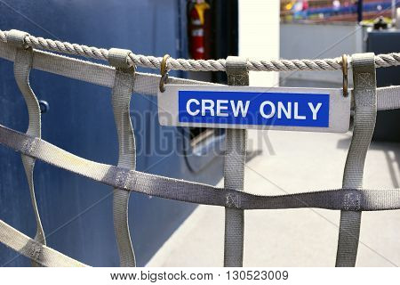 Crew only sign on boat rope gate