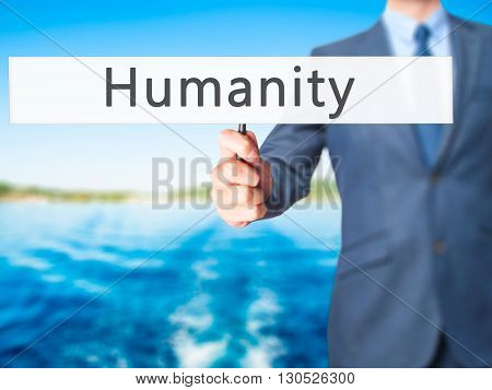 Humanity - Businessman Hand Holding Sign