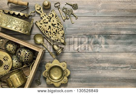 Vintage brass table ware. Kitchen table with antique tools and utensils