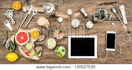 Kitchen table with bar tools accessories and electronic devices. Flat lay background