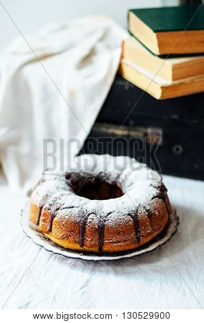 Summer Bundt Cake With Topped With Sugar Glaze, Close Up. Countr