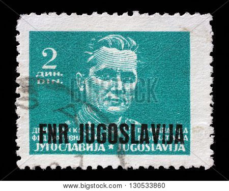 ZAGREB, CROATIA - JUNE 21: A stamp printed in Federal Democratic Republic of Yugoslavia shows Marshal Josip Broz Tito, circa 1945, on June 21, 2014, Zagreb, Croatia