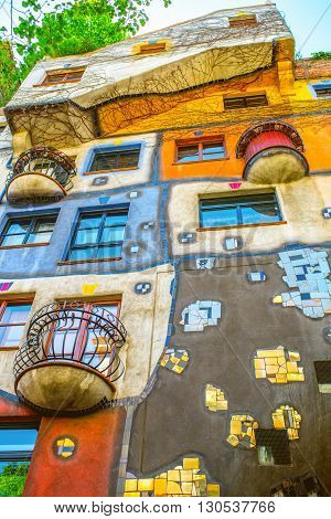 VIENNA, AUSTRIA - CIRCA APRIL 2016: Colorful apartment house  in Vienna named Hundertwasserhaus. This building is famous expressionist landmark designed by artist Friedensreich Hundertwasser