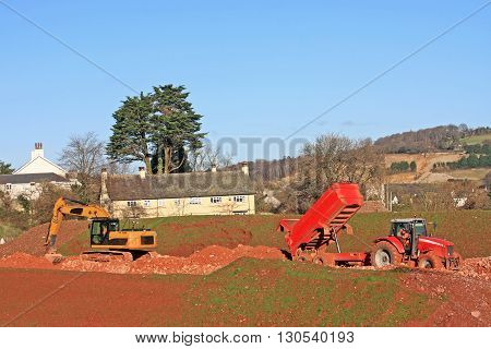 Tractor with tipper trailer on a construction site
