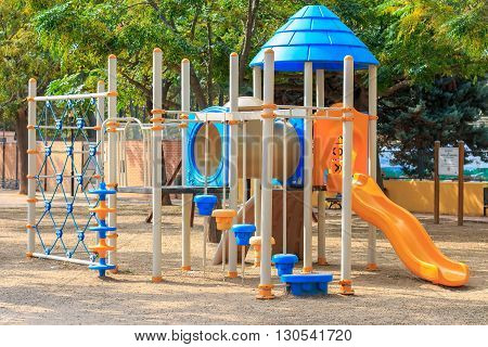 Сhildren playground multi unit with swings, agility equipment, slide and challenge net