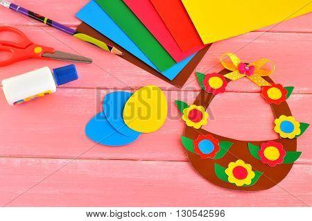 Sheets of paper, scissors, glue, pencil, Easter basket and eggs - set for children creativity. Paper kids craft idea