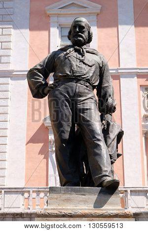 PISA, ITALY - JUNE 06, 2015: Giuseppe Garibaldi bronze statue by Ettore Ferrari in Pisa, Italy, on June 06, 2015