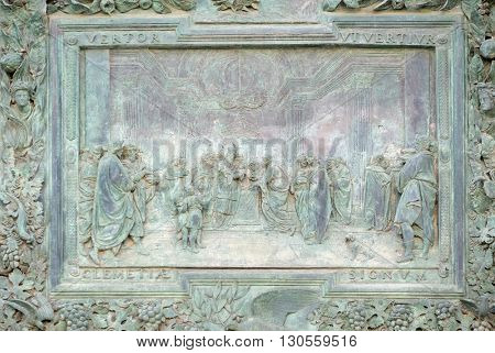 PISA, ITALY - JUNE 06, 2015: PISA, ITALY - JUNE 06, 2015: Presentation of Jesus at the Temple, detail of the central door of the Cathedral St. Mary of the Assumption in Pisa, Italy on June 06, 2015