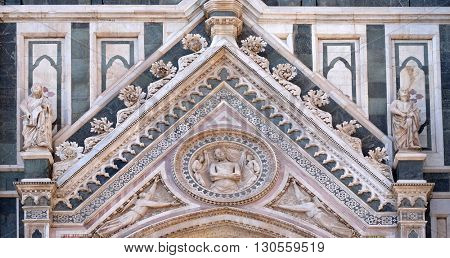 FLORENCE, ITALY - JUNE 05: Wrapping Christ in his shroud, Portal on the side-wall of Cattedrale di Santa Maria del Fiore (Cathedral of Saint Mary of the Flower), Florence, Italy on June 05, 2015
