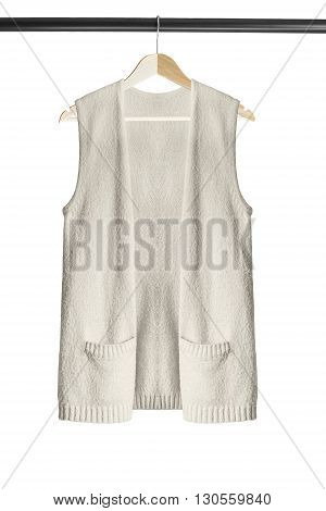 Beige cashmere vest on clothes rack isolated over white