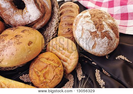 fresh healthy natural bread food group and wheat plant in studio on table poster
