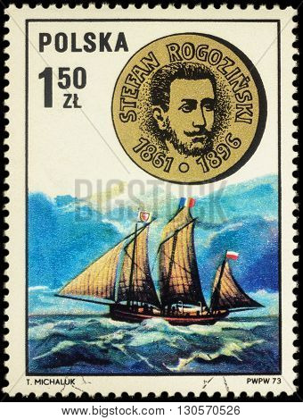 MOSCOW RUSSIA - MAY 17 2016: A stamp printed in Poland shows sailship and medal with bas-relief of Stefan Rogozinski - Polish explorer of Africa series