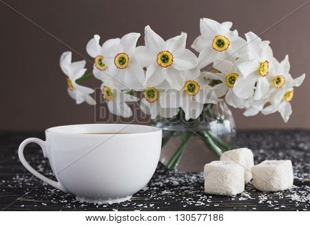 Cup Of Coffee, Rahat Lokum With Coconut And Narcissus On Black Wooden Background