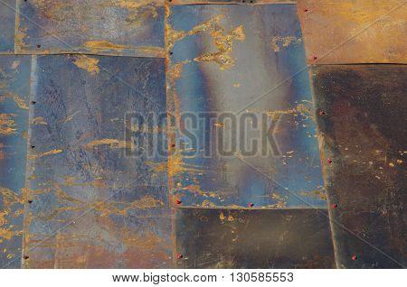 Not painted iron sheets close up with screws hats and rust.