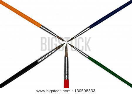 Artistic colored paint brushes isolated on white background