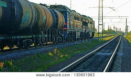 MOSCOW, RUSSIA - JULY 31, 2012: Freight train loaded with oil tanks is leaving Moscow for Saint-Petersburg