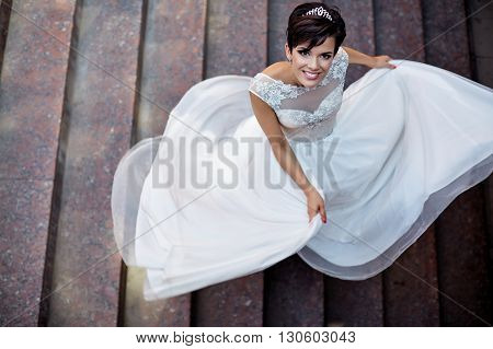 Wedding. Feeling weightless. Cheerful young bride on the happiest day of her life