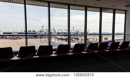 BANGKOK THAILAND - 12 SEPTEMBER 2015 - Airplanes connected to jetway at Don Muang international airport.