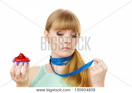 Woman Holds Cupcake Trying To Resist Temptation
