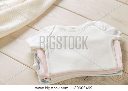 Pile Of Baby Shirts