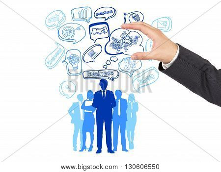 Hand with teamwork concept icon in bubble over businesspeople silhouettes