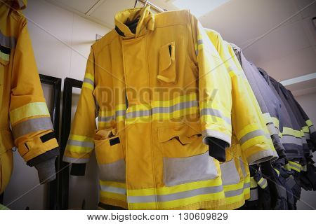 firefighter suit and equipment ready for operation, Fire fighter room for store equipment, Protection equipment of fire fighter.