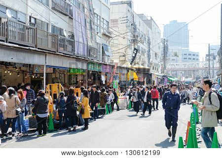 TOKYO, JAPAN -MARCH 29 2016: Street view at Tsukiji Market, Tsukiji market is a large market for fish, fruits and vegetables in central Tokyo, Japan. March 29 2016