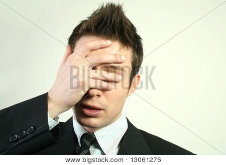 Portriat of a young businessman with stress. poster