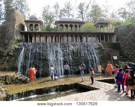 Chandigarh-Mar 14: People visit the Rock Garden built by self-taught artist Nek Chand Saini who started the garden secretly in his spare time in 1957. Rock Garden is made of recycled industrial and home waste. Rock Garden Mar 14, 2015 in Chandigarh, India