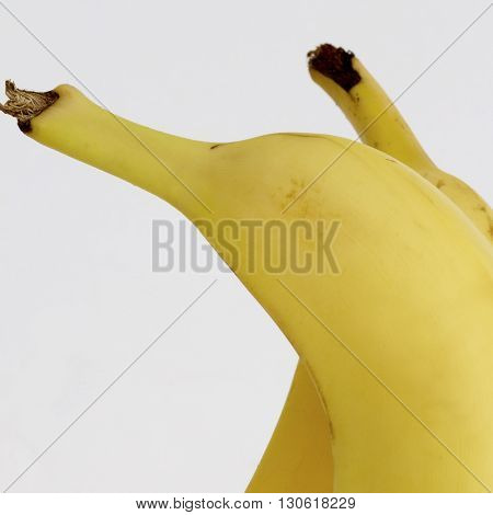 Two ripe yellow cavendish bananas together (Macro)