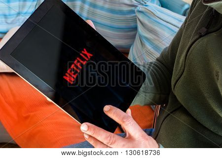 BARCELONA SPAIN - JANUARY 05 2016: Netflix logo on tablet screen. Netflix is an international leading subscription service for watching TV episodes and movies.