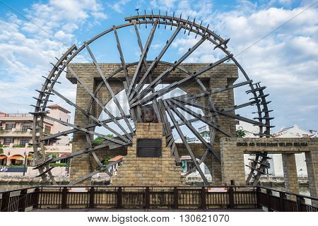 The ancient wooden water wheel nearby Malacca river in Malacca Malaysia.
