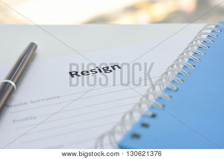 Draft of Resignation Letter and blue notebook
