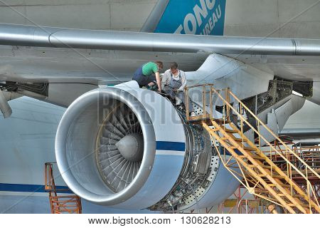 Kiev Ukraine - August 3 2011: Antonov An-124 Ruslan cargo plane engine being checked and maintenanced in hangar