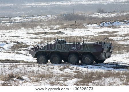 Zhitomir Ukraine - March 10 2011: Armored personnel carrier BTR-80 during the military trainings driving along the road