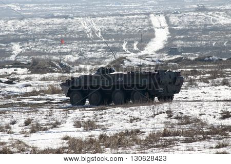Zhitomir Ukraine - March 10 2011: Armored personnel carrier BTR-80 during the military trainings on the shooting area