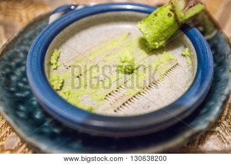 Japanese green horse radish in a wasabi bowl