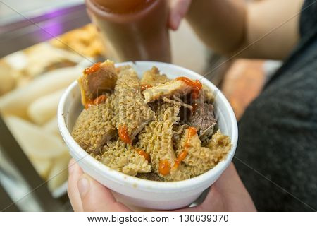 Cooked Chinese style tripe in takeaway cup