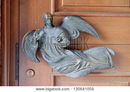 KLEINOSTHEIM, GERMANY - JUNE 08: Angel on the door of the Saint Lawrence church in Kleinostheim, Germany on June 08, 2015.