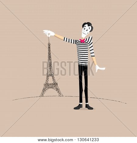 A Mime performing a pantomime holding the eiffel tower