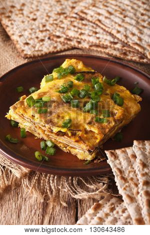 Jewish Cuisine: Matzah Brei With Green Onions Close-up. Vertical