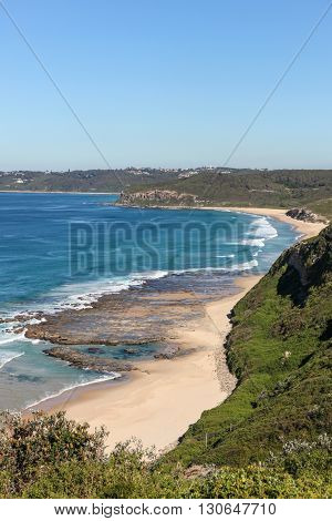 Burwood Beach viewed from above on a nice autumn day. Newcastle is a popular travel destination and home to many beaches such as this only a short distance from the CBD.