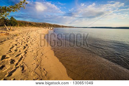 Sandy Lake Superior Beach. Panoramic sunny sand beach on the shores of Lake Superior in Pictured Rocks National Lakeshore. Munising, Michigan.