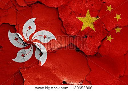 Flags Of Hong Kong And China Painted On Cracked Wall