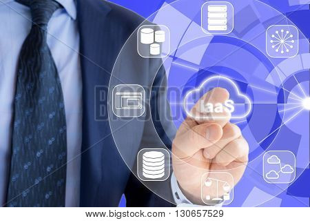IT expert in a blue suit is pressing a glowing cloud symbol with IaaS Infrastructure as a service and icons of services around